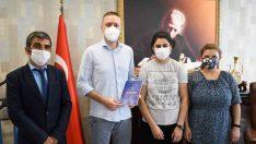 Kurum çalışanlarından 'Pandemide Saklı Yaşamlar' kitabı
